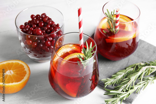 Foto auf AluDibond Cocktail Tasty refreshing cranberry cocktail with rosemary on table