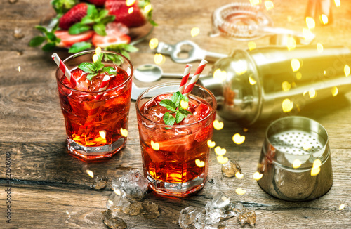 Obraz na plátně  Red drink Aperitif mojito caipirinha juice Vintage style bokeh