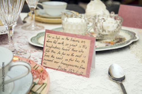 Photo women's tea and luncheon table setting with psalm passage writing on table