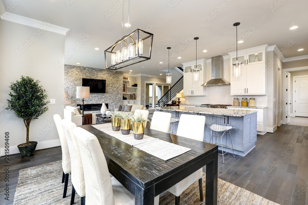 Obraz Beautiful kitchen in luxury modern contemporary home interior with island and chairs fototapeta, plakat