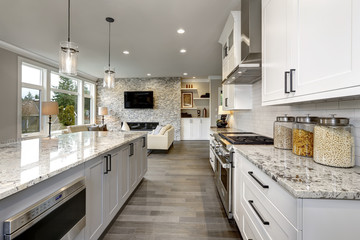 Fototapeta Beautiful kitchen in luxury home modern interior with island and stainless steel chairs