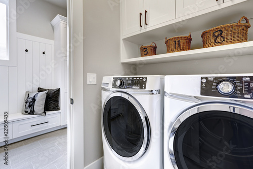 Papel de parede White clean laundry modern room with washer and dryer
