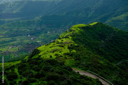 In de dag Groen blauw Beautiful landscape aerial, and closeup Photos of nature, roads, grass, trees, village, and farm land. Lush green monsoon nature mountains, hills, Purandar fort, Pune, Maharashtra, India