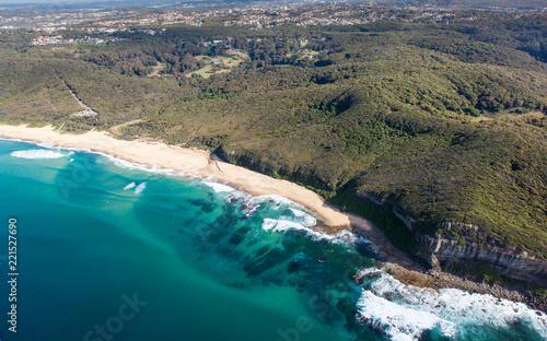 Poster Oceanië Aerial view of Dudley Beach - Newcastle Australia. This beach is surrounded by state park and is a popular beach for local surfers and beach goers.