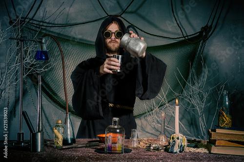 The alchemist creates an elixir of eternal youth. Halloween. Wallpaper Mural