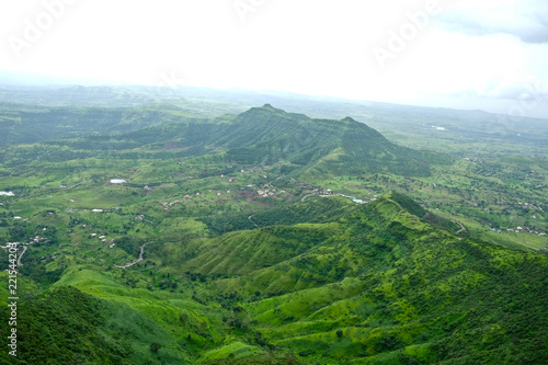 Fotobehang Wit Beautiful landscape aerial, and closeup Photos of nature, roads, grass, trees, village, and farm land. Lush green monsoon nature mountains, hills, Purandar fort, Pune, Maharashtra, India