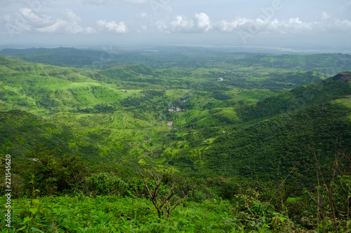 Fotobehang Landschap Beautiful landscape aerial, and closeup Photos of nature, roads, grass, trees, village, and farm land. Lush green monsoon nature mountains, hills, Purandar fort, Pune, Maharashtra, India