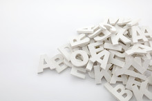 Pile Of White Painted Wooden Letters. Typography Background Composition.