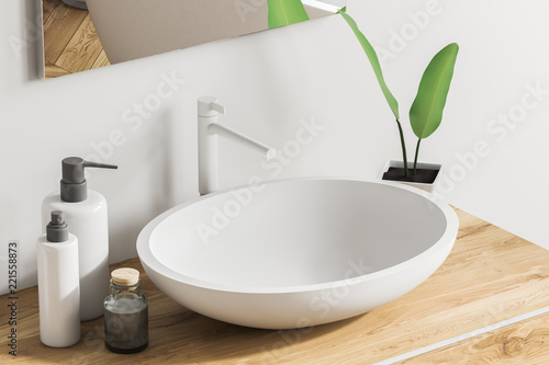 Fotografía  Close up of sink on wooden vanity unit, white