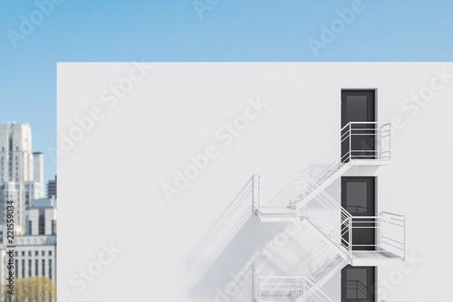 Staande foto Stad gebouw White building with fire escape ladder, city
