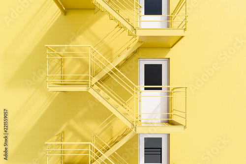 Deurstickers Stad gebouw Yellow building with fire escape ladder