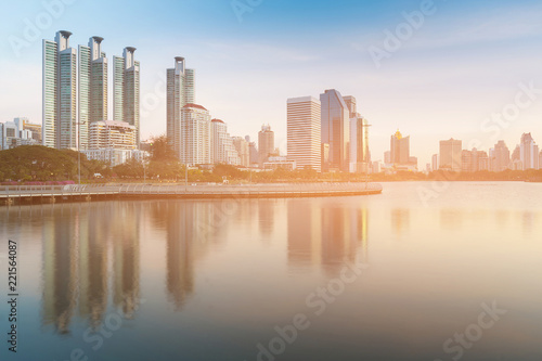 Staande foto Stad gebouw City apartment view over water lake reflection in public park, Bangkok Thailand
