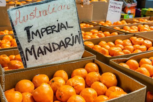 Carta da parati Mandarins are for sale in cardboard boxes at the Queen Victoria Market in Melbourne, Australia