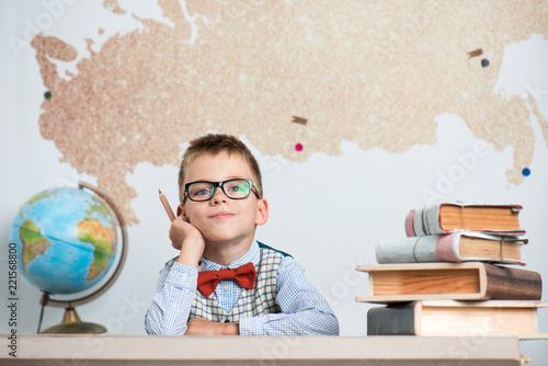 Fotografie, Obraz  Schoolboy wearing glasses and a bow tie