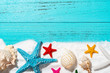 white sand and sea shells and starfishes as summer holidays concepts