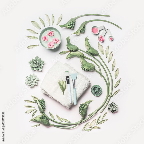 Garden Poster Spa Natural spa and skin care composition with water bowl , flowers, green leaves, towel and accessories for facial mask on white background, top view. Healthy lifestyle and beauty concept