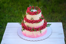 Wedding Cake In Three Tiers With Fresh Raspberries