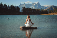Woman Meditation In Mountain Lake