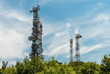 canvas print picture - Iron Telecommunication tower with group of parabolic antennas.