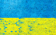 canvas print picture - Brick wall painted in the colors of the Ukrainian flag.