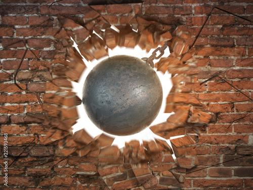 Fotografía Wrecking ball destroying the brick wall