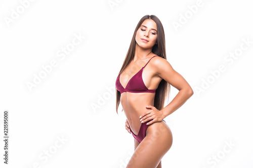 Fototapeta Young woman with beautiful slim perfect body in bikini isolated white background obraz na płótnie