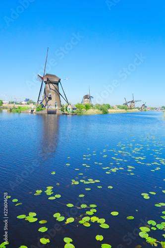 Papiers peints Con. ancienne traditional dutch rural scenery with windmills on river in Kinderdijk at summer day, Netherland