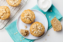 Healthy Vegan Oat Muffins, Apple And Banana Cakes With Sour Cream On A White Plate. Blue Stone Background. Top View.
