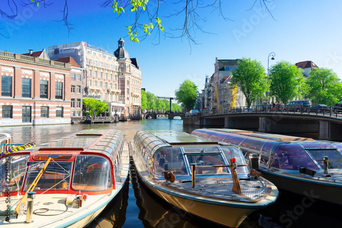 canal in the center of Amsterdam with Munt tower, Netherlands Canvas Print