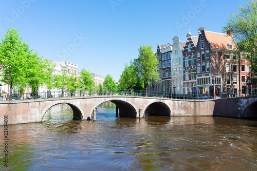 Papiers peints Con. ancienne historical houses of Amsterdam over canal ring landmark in old european citye, Holand Netherlands. Amsterdam spring scenery