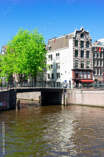 Papiers peints Con. ancienne bridge and houses of Amsterdam over canal ring landmark in old european city, Holland Netherlands