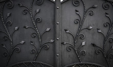 Details, Structure And Ornaments Of Forged Iron Gate. Floral Decorative Ornament, Made From Metal.