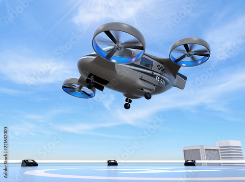 Fotografija  Metallic gray Passenger Drone Taxi takeoff from helipad