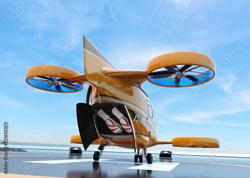 Valokuva  Rear view of orange Passenger Drone Taxi on helipad