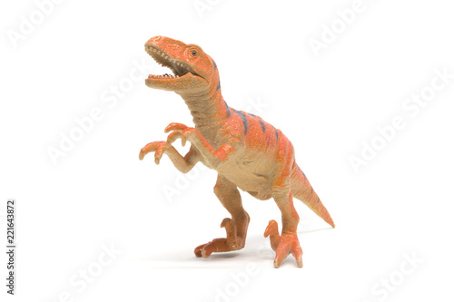 Naklejka premium Plastikowa zabawka velociraptor na białym tle