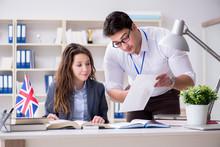 Teacher Explaining To Student At Language Training