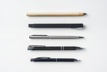 Collection Of Pens On White Background