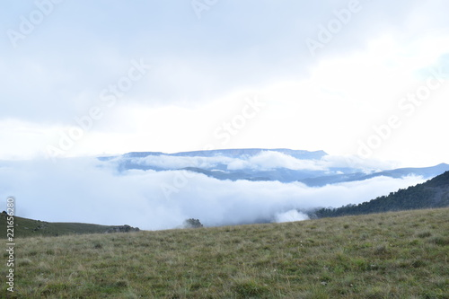 Foto op Canvas Khaki landscape with mountains and clouds