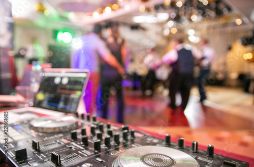 The disco, Banquet, people blurred background dancing. Dj panel Wallpaper Mural