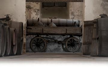 Fototapeta na wymiar old wine barrel cellar with original cart