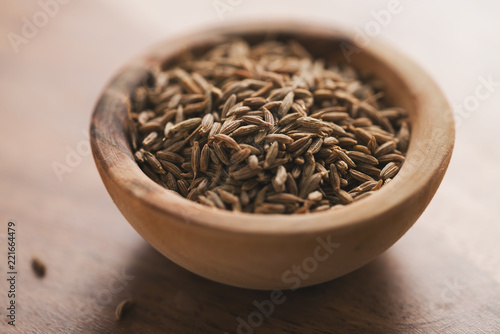Fototapeta cumin zira seeds in wood bowl on table obraz