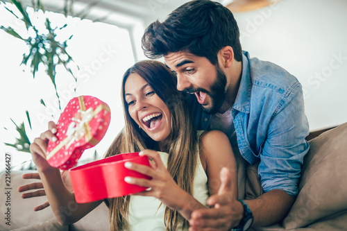 Fotografija  Man giving a surprise gift to woman at home