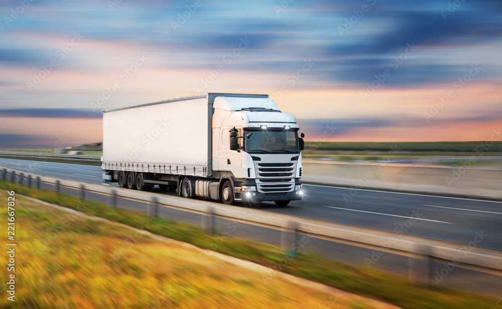 Fototapeta Truck with container on road, cargo transportation concept.
