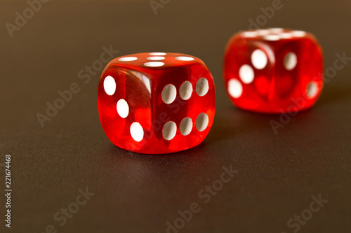 фотография  Dice on a black background . Game concept. Games of chance.