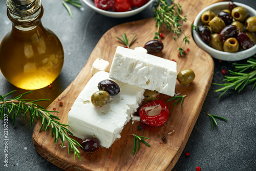 Greek cheese feta with thyme, rosemary, olives and stuffed red bell peppers
