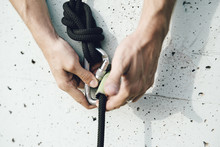 Close Up Of Aerial Dancer Hands Handling Ropes For Safety In A Wall