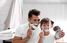 Father And Son Having Fun While Shaving In Bathroom