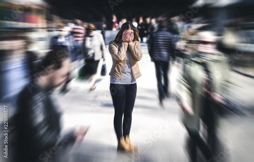 fototapeta na drzwi i meble Panic attack in public place. Woman having panic disorder in city. Psychology, solitude, fear or mental health problems concept. Depressed sad person surrounded by people walking in busy street.