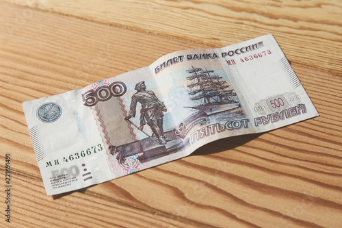 Fotografering  A 500 Russian Ruble banknote on a wooden table top