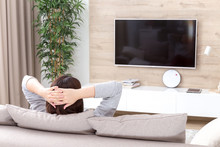 Young Woman Watching TV In The...